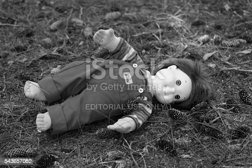 Fosston, USA - June 25, 2016: A vintage My Buddy doll has been abandoned on the ground in the woods.  Made by Hasbro in 1985, the My Buddy boy doll was intended to appeal to little boys and teach them about caring for their friends.