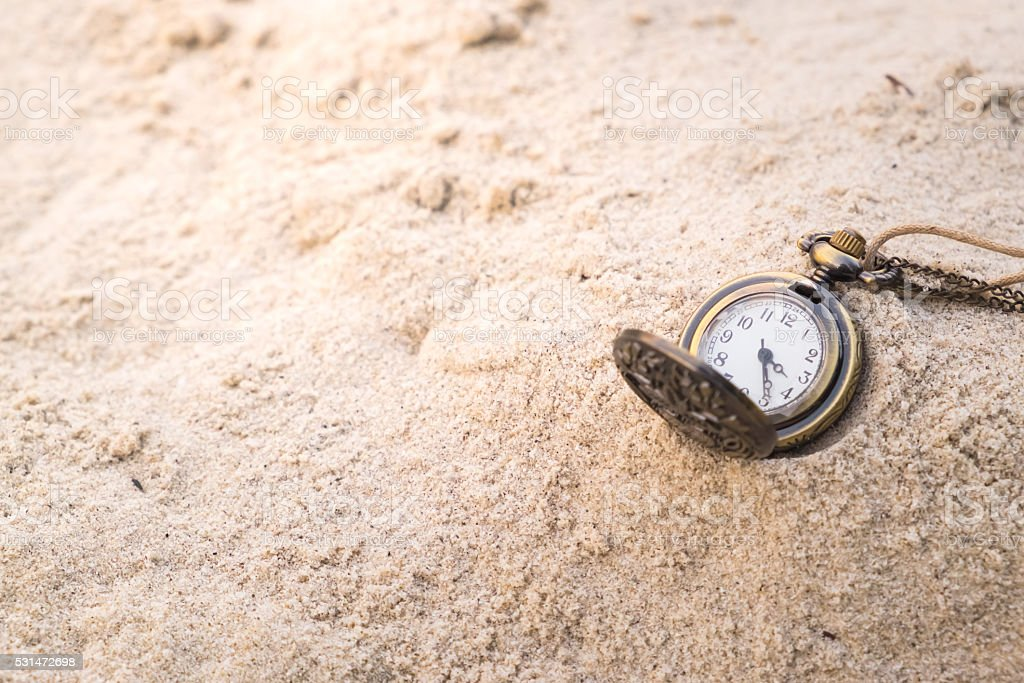 Vintage Necklace Watch on the sand stock photo
