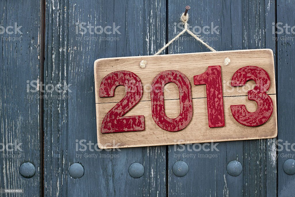 Vintage New Year 2013 date wooden board hanging on nail royalty-free stock photo