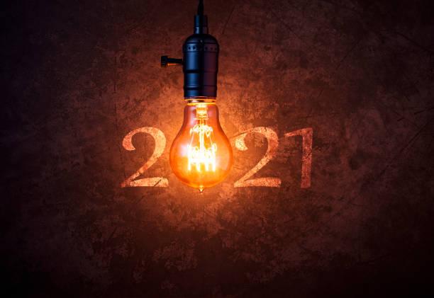 Vintage New Year 2021 - Light bulb New Years Eve Christmas Retro Grunge stock photo