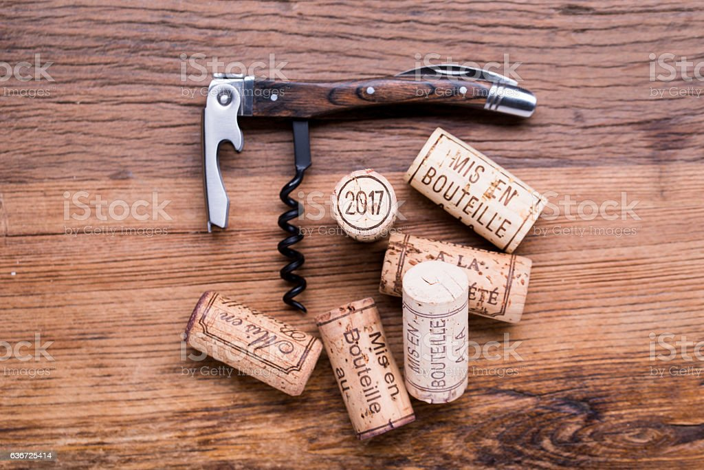 2017 vintage new year wine cork corkscrew wooden table background stock photo