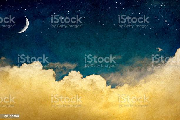 Photo of Vintage night sky with crescent moon and clouds