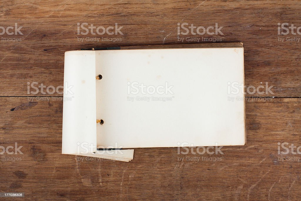 Vintage notebook (original) on wooden background royalty-free stock photo