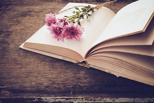 vintage novel books - vintage flowers stock photos and pictures