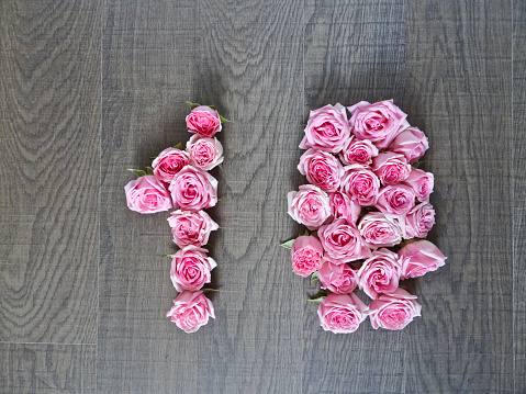istock Vintage number of pink roses on the background of dark wood 1141166972