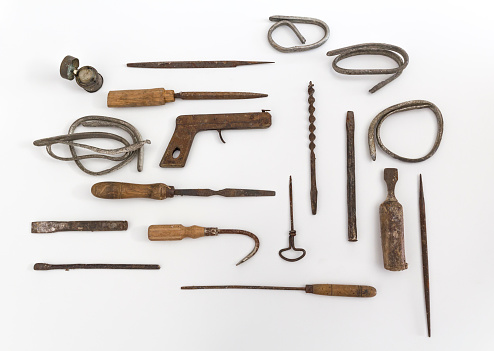 Ancient tools for building industry of 1900, placed on a white background.