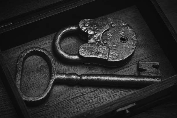 vintage objects - a key and a lock. real antiques - schloss aus karton stock-fotos und bilder