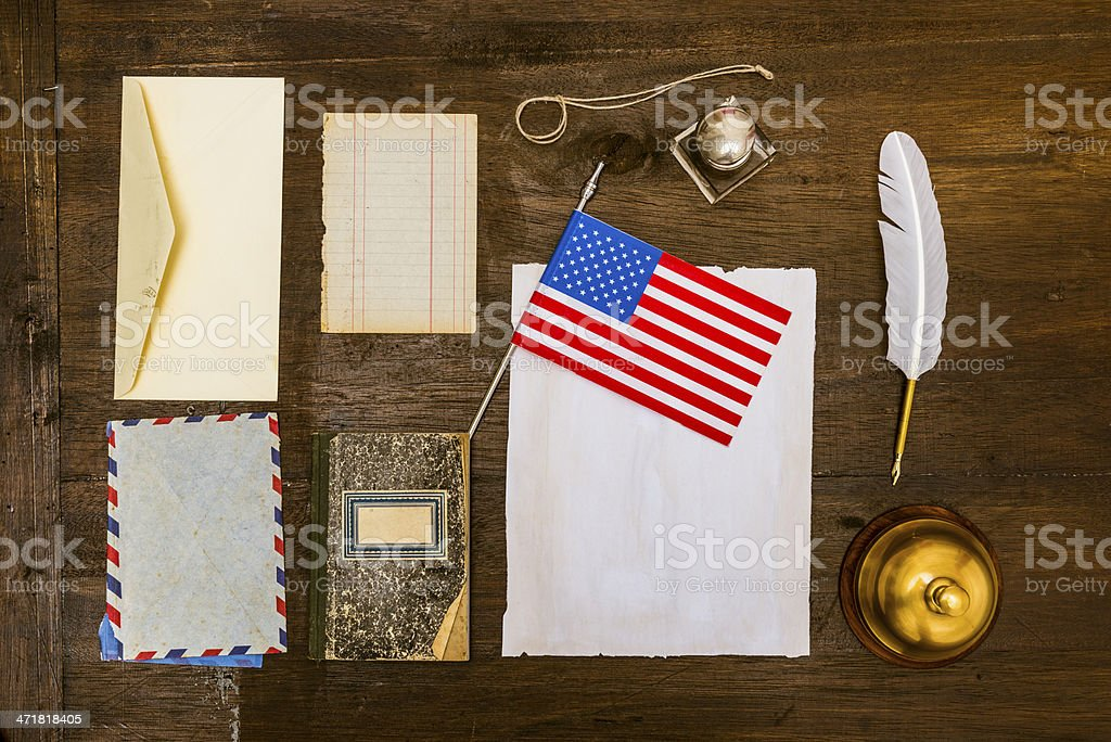 Vintage objects on old wooden desk royalty-free stock photo