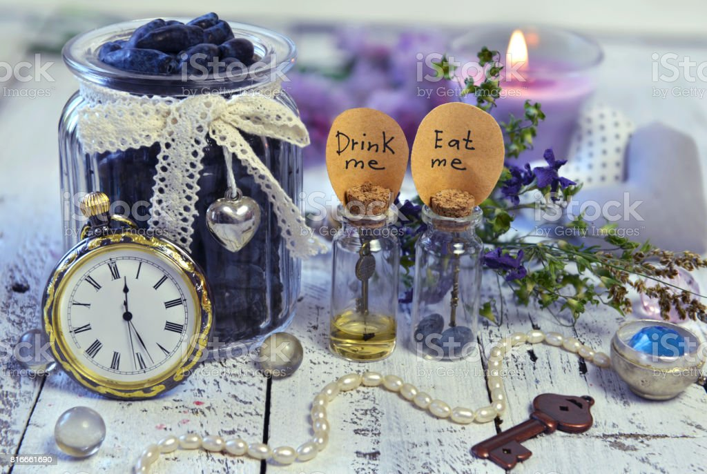 Vintage objects, tiny bottles, old clocks, key and honey berry stock photo