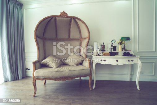 istock Vintage of brown sofa and untidy desk 504369059