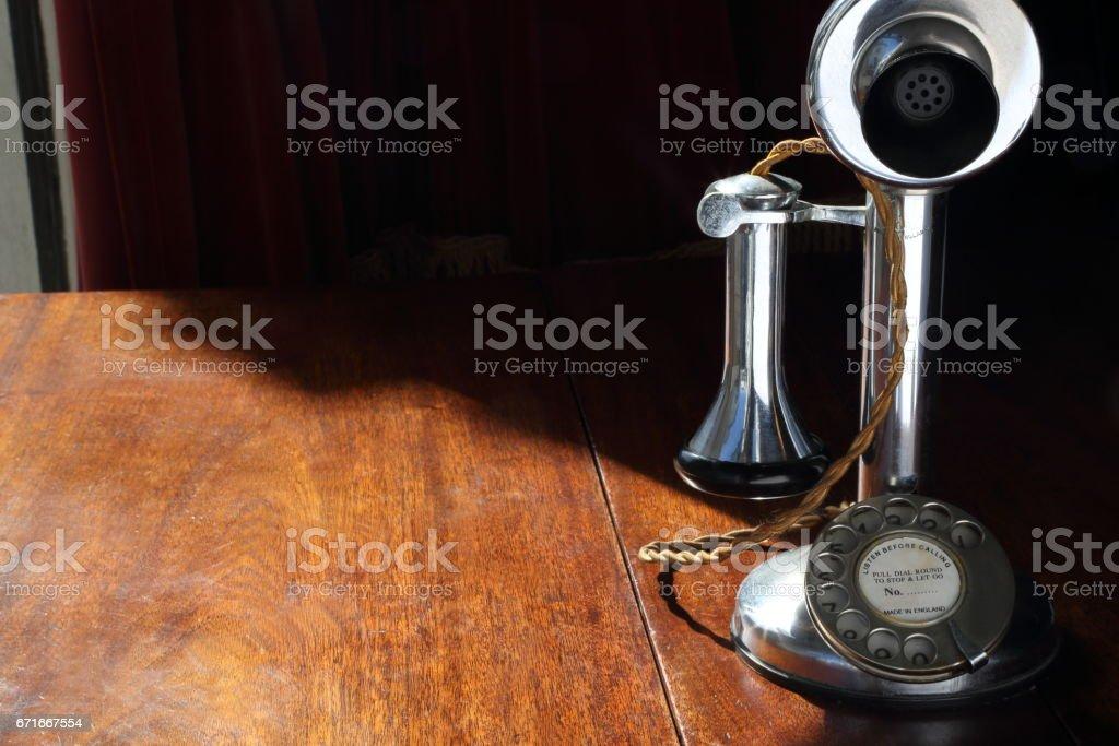 Vintage office equipment on wood desk stock photo