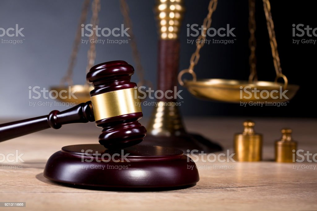 Vintage office room in a law firm with the legal hammer and the scales of justice on the table. stock photo