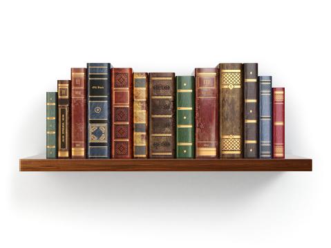Vintage old books on shelf isolated white.