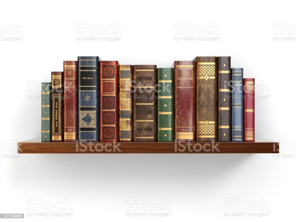 Vintage old books on shelf isolated white. stock photo