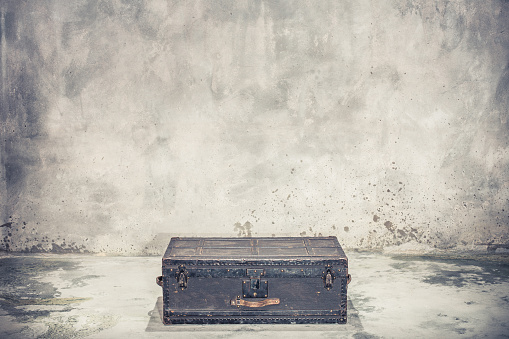 Vintage old classic travel trunk luggage with leather handles circa early 1900s. Travel concept. Retro style filtered photo
