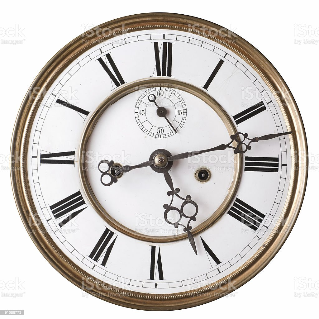A vintage, old clock with brass hands stock photo