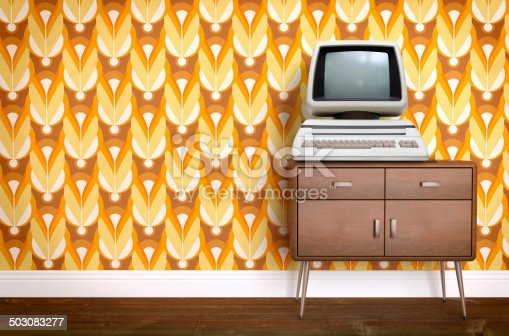 181053292istockphoto Vintage old computer on sixties, seventies wallpaper and furniture 503083277