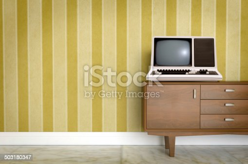 181053292istockphoto Vintage old computer on sixties, seventies wallpaper and furniture 503180347