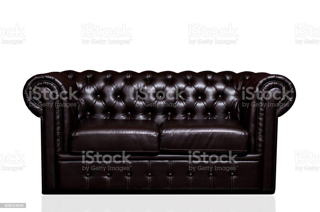 Vintage old dark brown leather sofa stock photo
