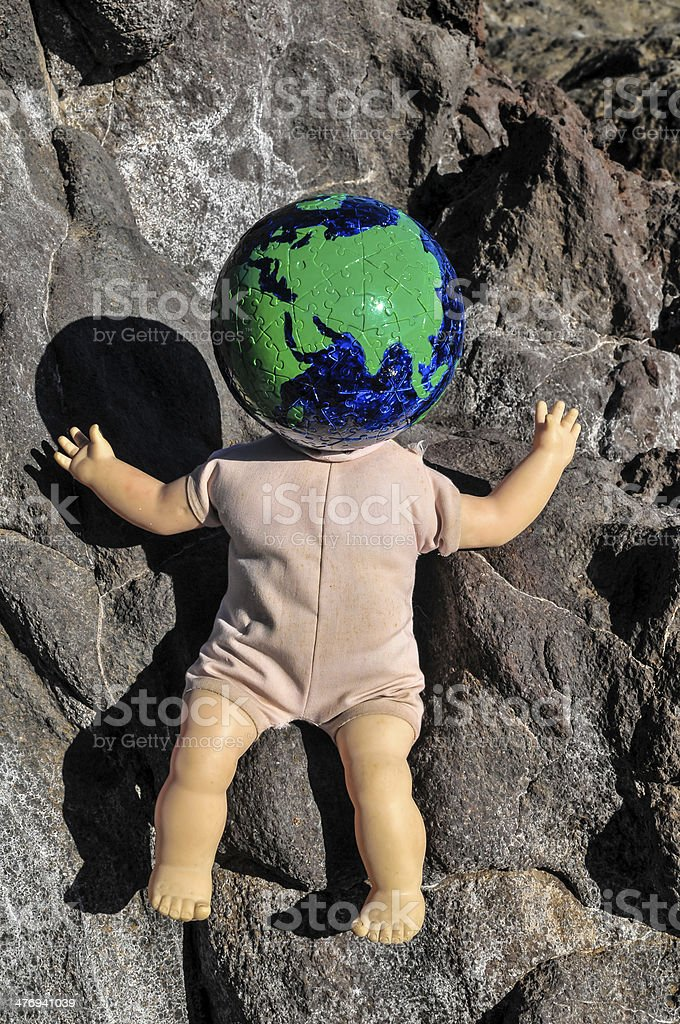 Vintage Old Doll with a Globe stock photo