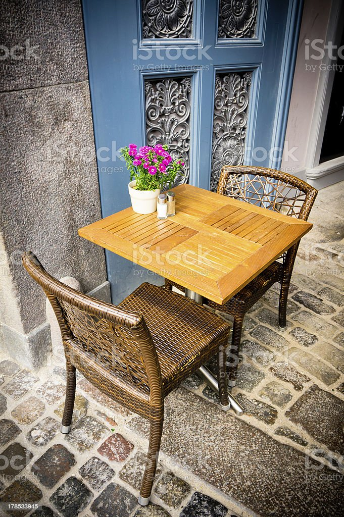 Vintage old fashioned cafe chairs with table in Copenhagen, Denm royalty-free stock photo