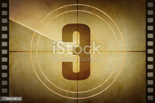 Vintage old film projector countdown screen with the number 3 at the center.