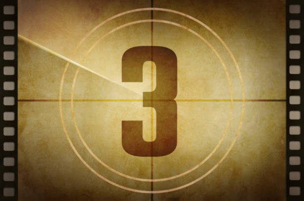 vintage old film projector countdown screen with the number 3 at the center - terceira imagens e fotografias de stock