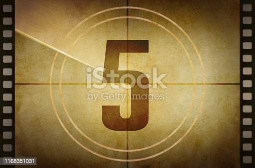 Vintage old film projector countdown screen with the number 5 at the center.