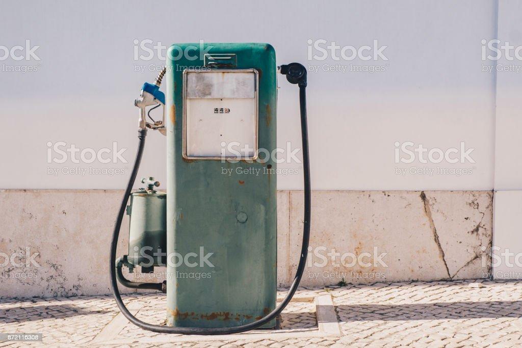 Vintage old gasoline pump and oil dispenser stock photo