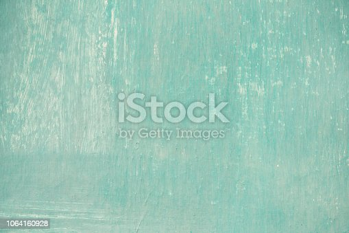 istock Vintage old grunge aquamarine painted street wall texture background. Retro style filtered photo 1064160928