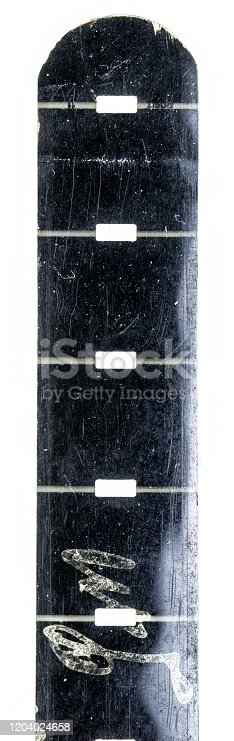 1125303139 istock photo vintage old nine and a half or 9,5mm film strip with middle or central perforation isolated on white background, safetyfilm or old school exposed filmstripe. 1204024658