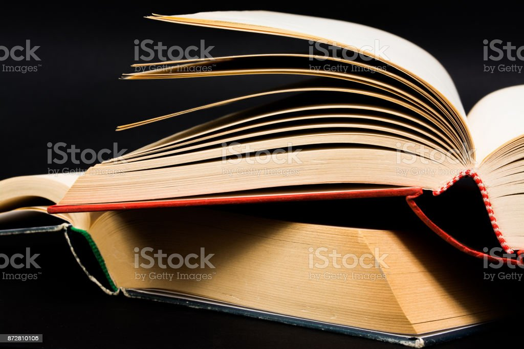 Vintage Old Open Book On Black Background Stock Photo