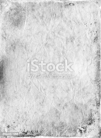 istock Vintage old paper textured background 854462588