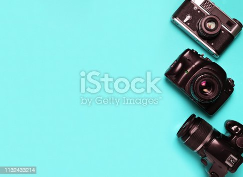 istock Vintage old photo camera on a blue background 1132433214