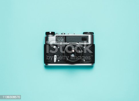 istock Vintage old photo camera on a blue background. Retro concept 1136308570