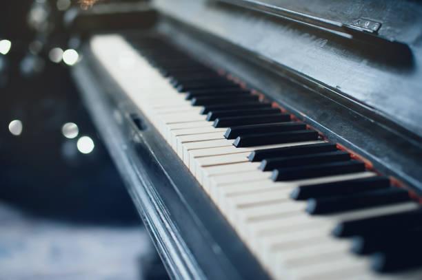 Vintage old piano. Close-up of keyboard keys stock photo