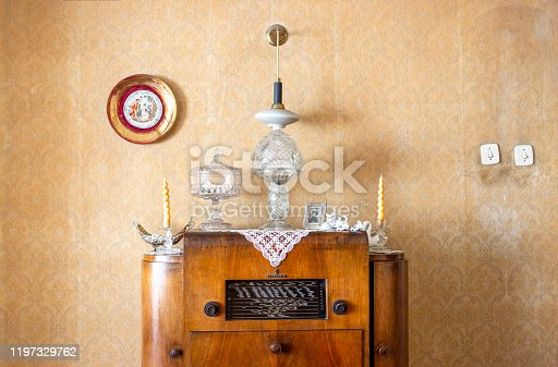 181053292 istock photo Vintage old radio on sixties, seventies wallpaper and furniture, antique 1197329762