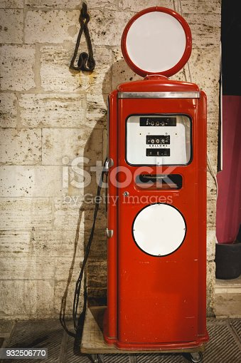 Vintage old red and white gas station pump. Portrait format.