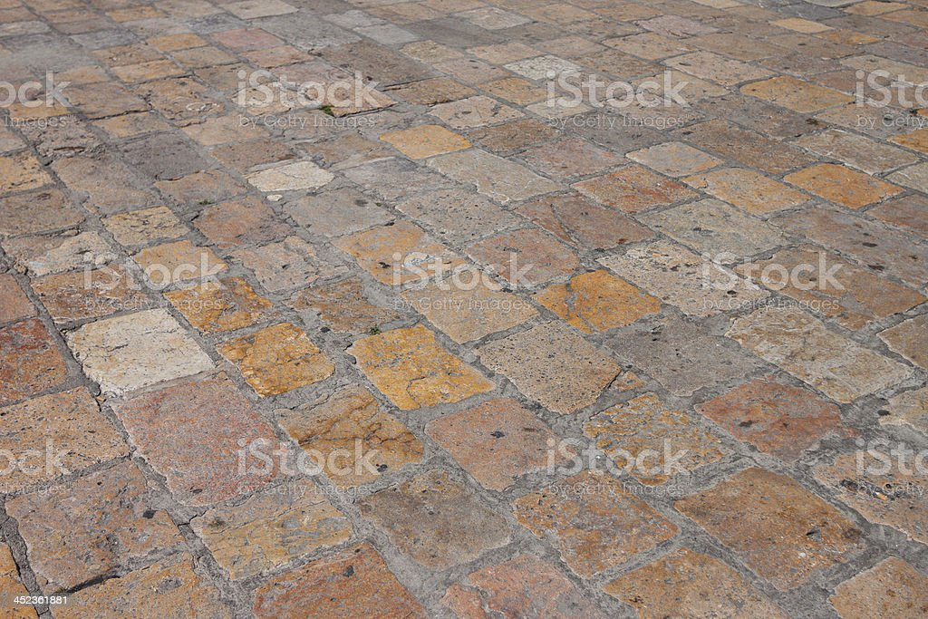 Vintage old stone paved avenue street road royalty-free stock photo