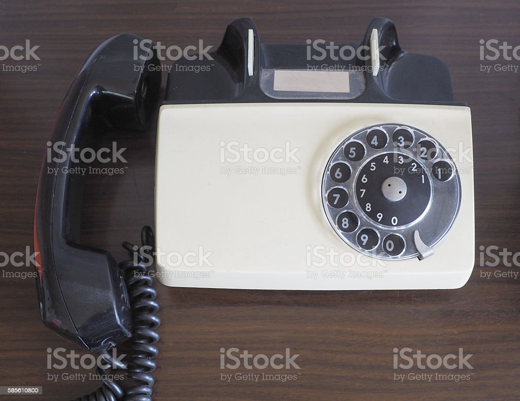 Vintage old telephone on wood table stock photo