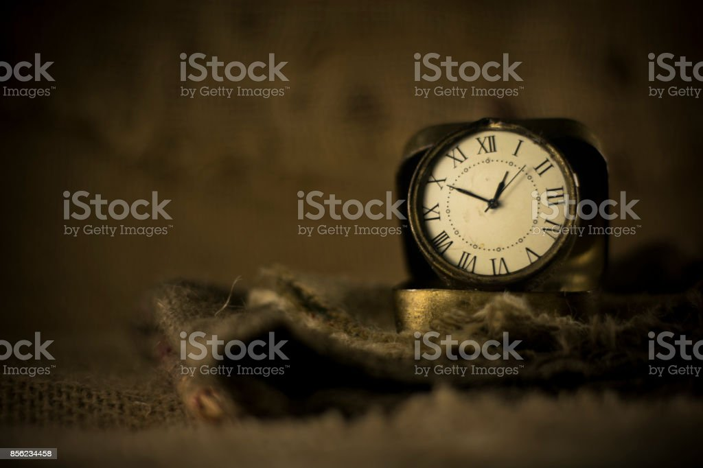 vintage old watch on burlap stock photo