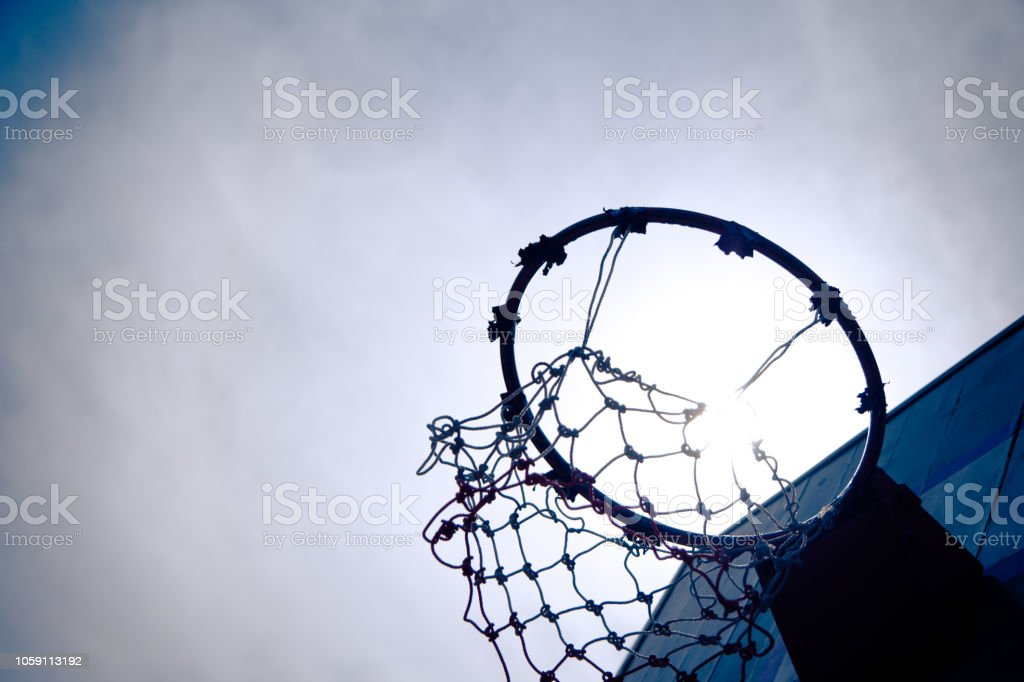 Vintage Old Wooden basketball hoop under the sunset that mean hit the...