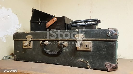 istock A vintage one classic travel leather suitcase around the 1940s. Luggage concept 1240204950