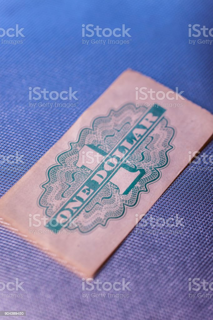 Vintage One Dollar Paper Token stock photo