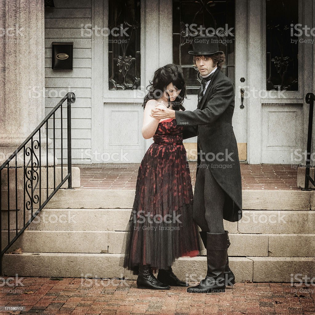 Vintage outdoor portrait of a young couple dancing stock photo