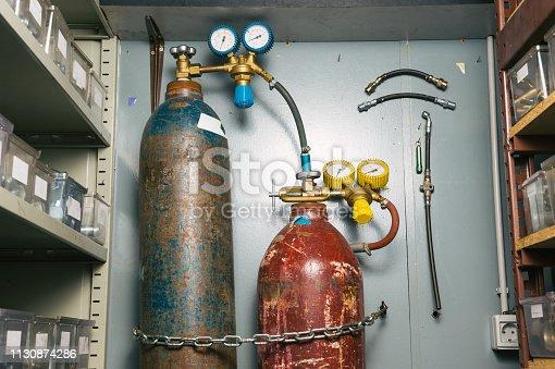 Vintage oxygen tanks in warehouse