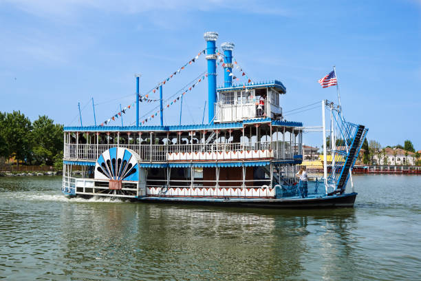 vintage paddlwheel steamboat painted in old-fashioned american in the river - historic vs new stock photos and pictures