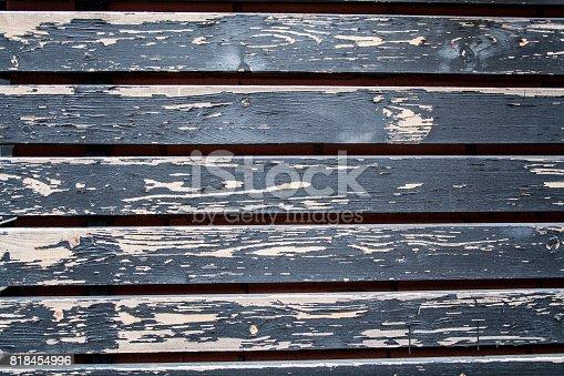 painted black faded/vintage hardwood siding. background.