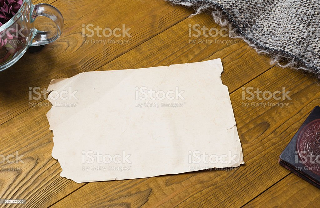 Vintage paper sheen with copyspace on wooden table stock photo