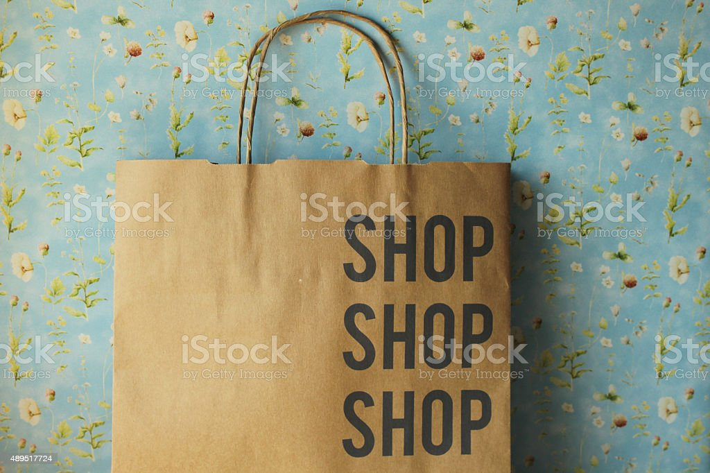 Vintage paper shopping bag stock photo